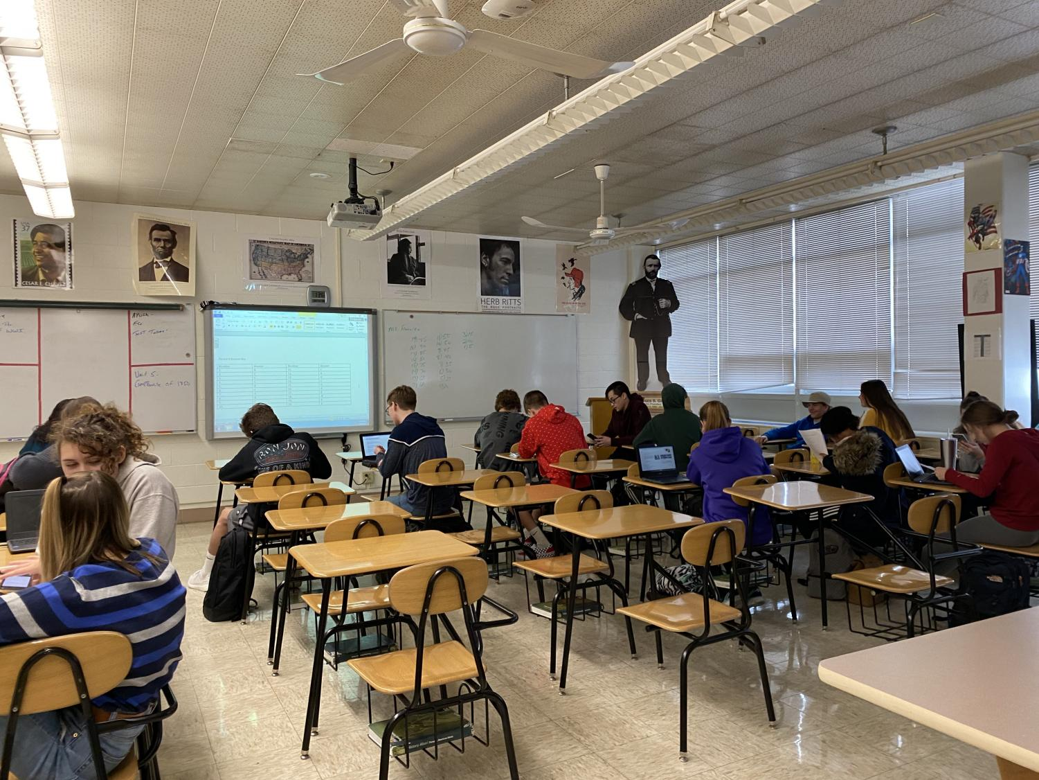 """With the AP exam just months away, Joseph Flahrety's AP US History class finishes a period test. """"The hardest part about taking the period tests is remembering what we learned and then applying it to the multiple choice questions. However, you learn from mistakes and then you know what to study next time,"""" sophomore Abbie Hambleton said."""