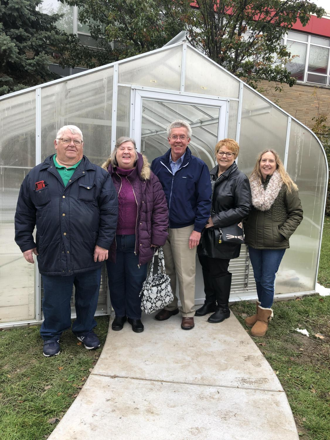 "From left to right: 1969 West graduates Charles Hudson, Jan Rangel, Steve Arp, Bobbie Noel-Behrens, and Jo Faris are members of the West's class of 69' reunion committee. They are in in front of the greenhouse that they donated $4,000 to on Nov. 1. 2019. ""My years at West were so important in establishing my personal core values. Friendships made at West have endured 50 years and is the main reason for large attendance at our class reunions. The greenhouse project has been the perfect way for the class of 69' to show our gratitude and 'pay it forward' to current and future West students,"" class of  69' West graduate Steve Arp said."