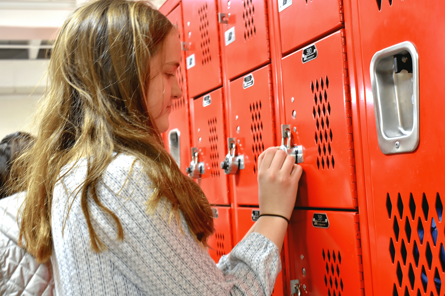 Sophomore Maureen Campbell keeps her things on the gym locker after second block PE class