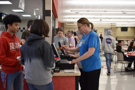 "At West during C lunch, students put in their ID or pay for lunch, meanwhile the cafeteria staff help at the registers ""Whenever you get food, they are always mostly smiling they"