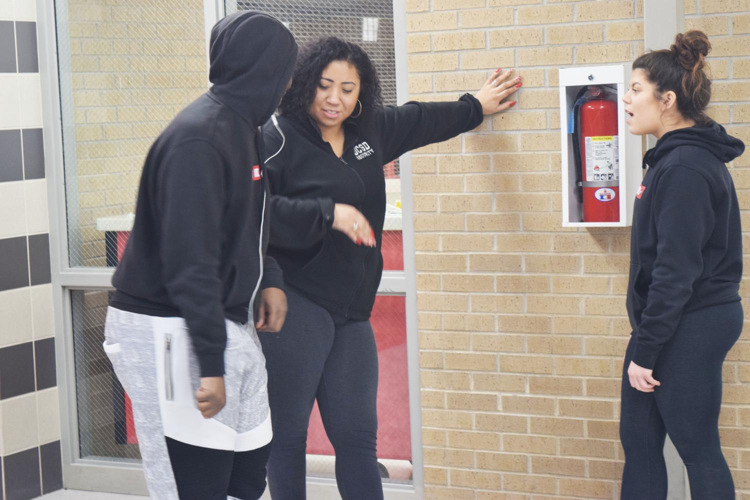 Security professional Shay Serrano talks to two students at West about their daily conflicts with some of the teachers. Serrano allows students to come to her whenever they need advice with anything or if they just want to talk about their day.