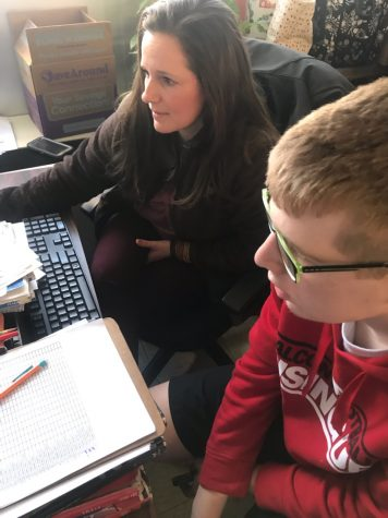 Spanish teacher Stephanie Hansen helps her advisory student sophomore Caleb Heskett sign up for Falcon Flex. Hansen allows her advisory students to sit in the back chairs by her desk, allowing conversations to flow throughout the class.