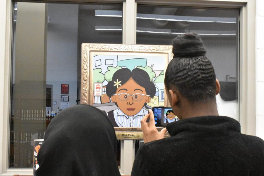 Cultural Diversity Club students junior Farnaiza Gulam and sophomore Tray Anna Thomas, visited the library during Falcon Flex, along with the rest of the club to see the new Civil Rights augmented reality exhibits.