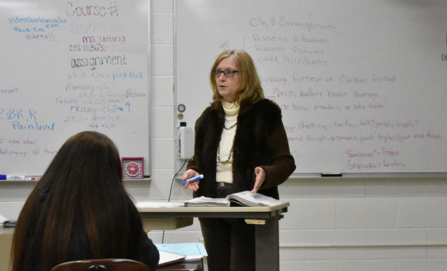 Science teacher Joan Jutting discussing in her fourth block Certified Nursing Assistant (CNA) class. West is the only school that offers CNA as a dual-enrollment class within the Davenport School Community District.
