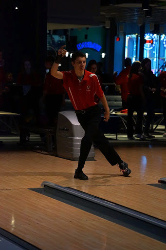 "Steven Daily '22 bowls during a meet last season. Daily has lots of bowling experience when it comes to bowling. He began bowling seven years ago in seventh grade, at League at 30 Lanes bowling alley. ""Bowling is fun, and you are usually independent, so you have to practice endlessly,"" Daily said."