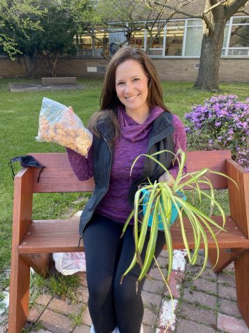 Spanish teacher Stephanie Hansen proudly holds her go-to meal of chicken nuggets along with her favorite plant. Hansen explained how she ironically had the chicken nuggets at school as she was sharing with those around her. Not surprising, her care for others is always showing.