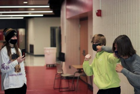 Two students engage in a fight while a third student records. For some students, pulling out their phone to record would be their first instinct if a fight went down. However a majority of students would do the good and try to avoid it. A survey of West students found that 50 percent of students would evade a fight if it were to break out near them.