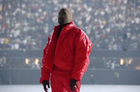 Kanye West wearing one of his signature outfits during the release of Donda. In the past, West has been known for his unique style, and this outfit is just another example.