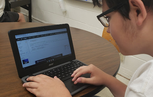 Sophomore Sean Brown is working hard on his T.A.G. project, coding and making a video game.